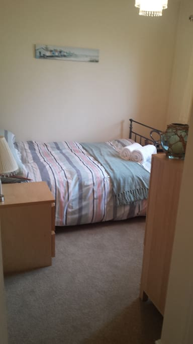 Light and airy double bedroom with a super comfy bed and ample storage space.