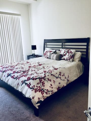 Master bedroom with King bed, plus private outdoor patio. And yes - there is a walk in closet!