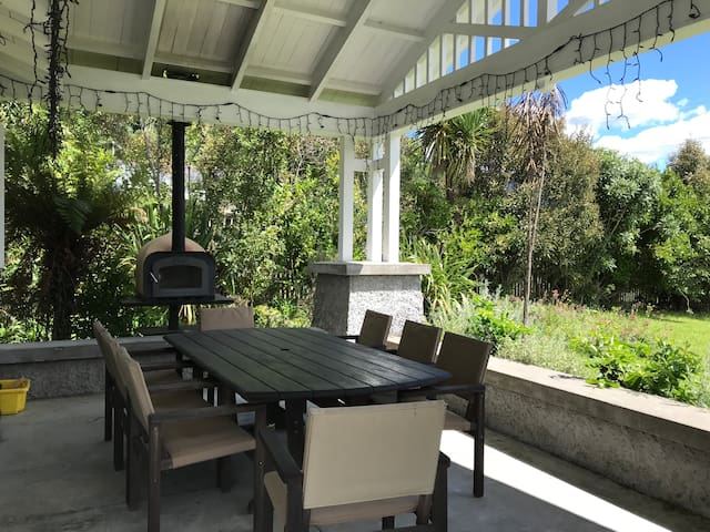Front verandah, table and pizza oven