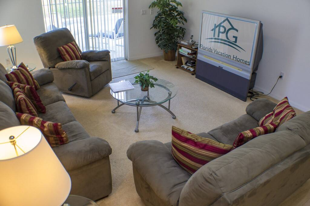 "The Family Room,With 50"" Flat Screen TV & Patio Doors to the Pool Area."