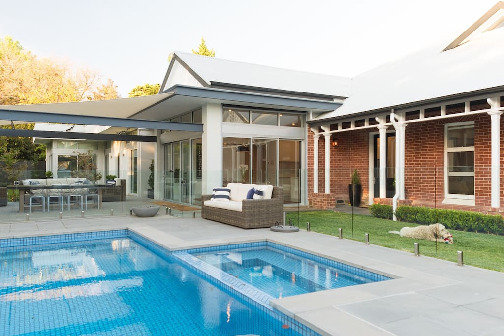 Outdoor dining area with pool & spa