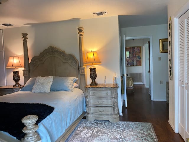 Spacious upstairs master bedroom with jacuzzi bath and shower