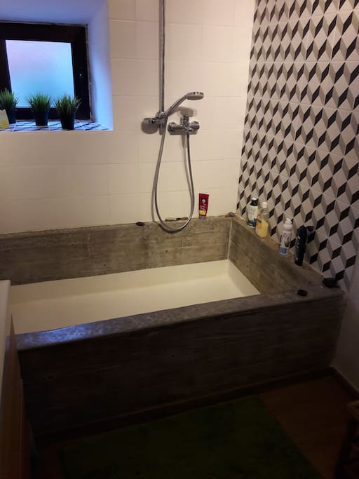 Bathroom with hand made concrete bath( 1m x 2m)
