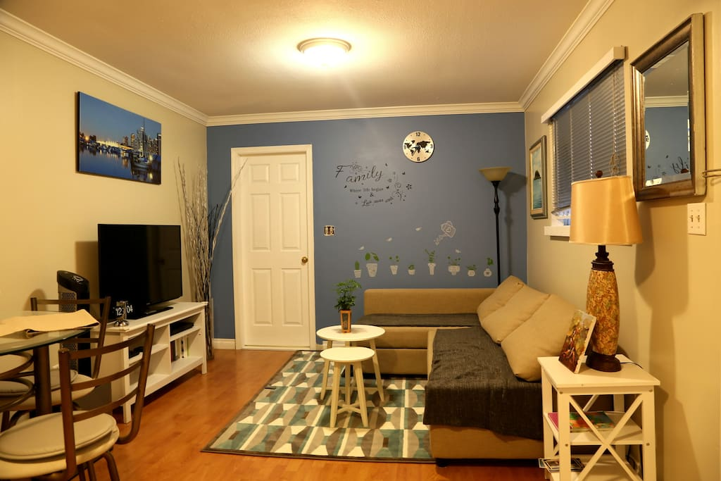 Spacious and bright living/dinning area. Behind the white door is a large bedroom.