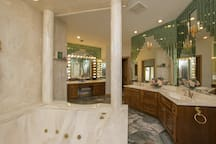 Bathroom adjoining to bedroom. Large jetted tub and walk-in shower