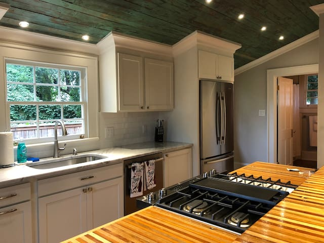 There is a beautiful high end gas range inlaid directly to the island in the middle of the kitchen. All the appliances are stainless steel and brand new including the dishwasher and the refrigerator.