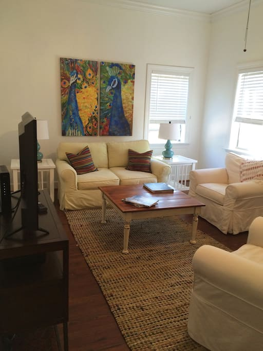 "Bright, comfortable living area with 10' ceilings and a 39"" TV"