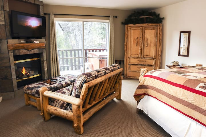 Suite with personal hot tub and gas fireplace