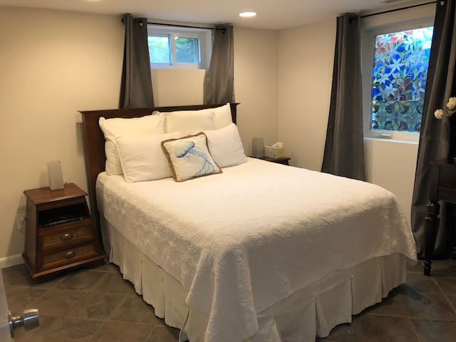 Private bedroom in Basement Apartment.
