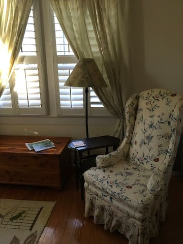 Bedroom decor with new plantation shutters.