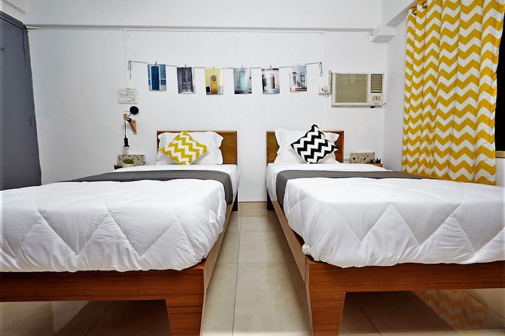 Room  with 2 sturdy Single beds, Orthopedic mattresses and Dr. Back pillows for an incredibly restful sleeping experience.