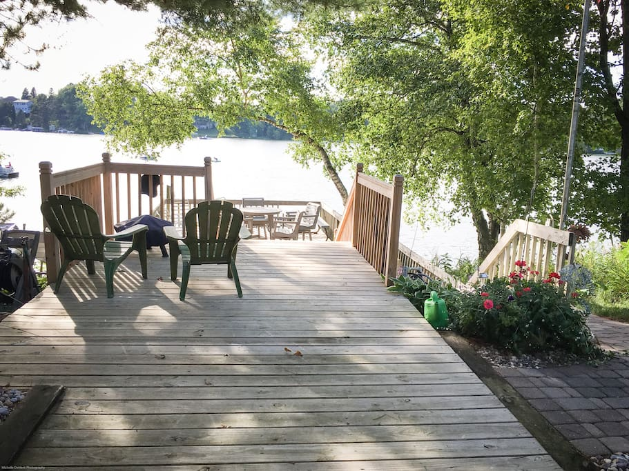 Your view of the quiet bay our boathouse sits on, with two docks just out of sight and a hot tub behind this photo.