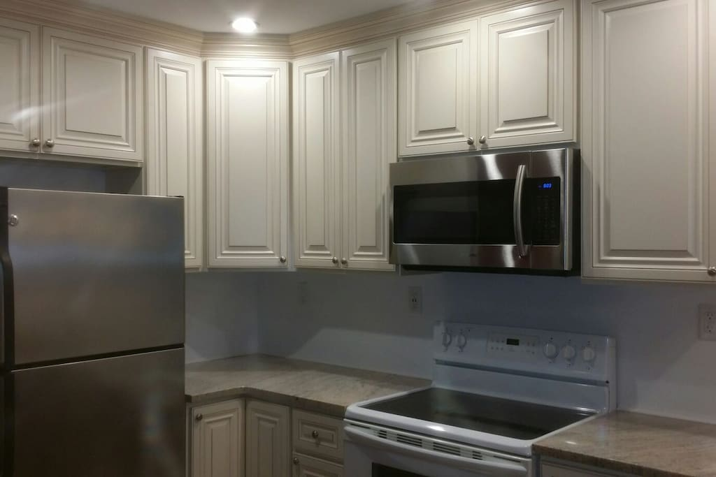Awesome kitchen w granite, microwave electric oven, view of bay, plenty of storage.
