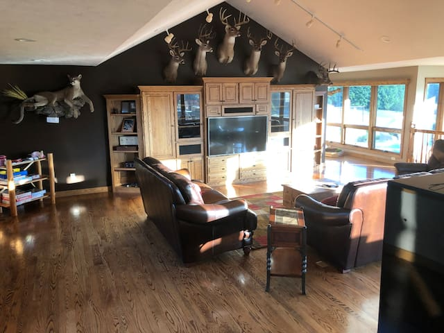 Great room with trophy mounts and wide screen TV