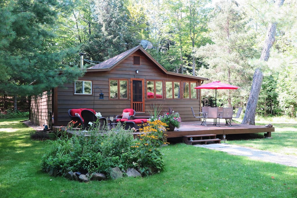 The front of the cottage. 300 feet away from the shoreline. You can see the lake a bit through the forest.