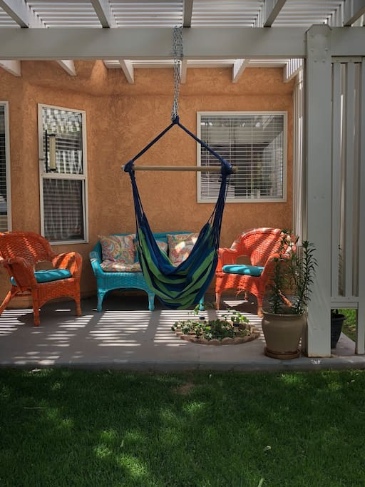 Outdoor seating area with hammock swing