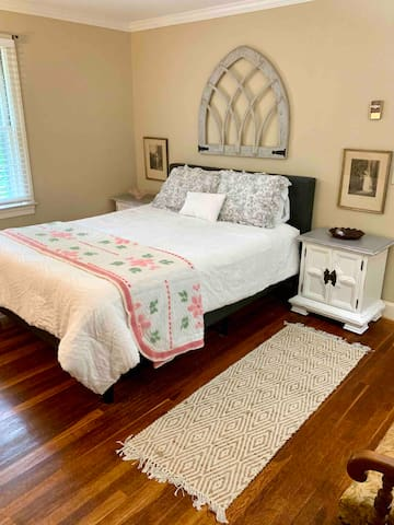 The master bedroom features a queen bed with a comfy mattress and cozy, soft sheets and blankets.