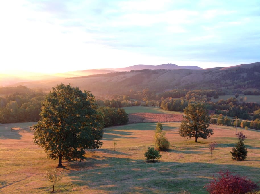 This view awaits you  from one of the three balconies and all the bedroom windows.  This is an autumn dawn :)