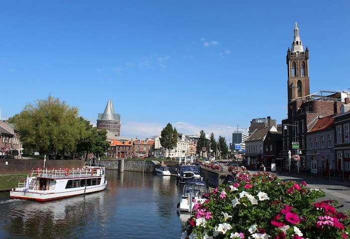 """A view of Roermond from the """"Roerkade"""". There are many pubs in the street."""