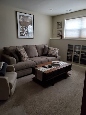 Your living room with comfy pull out sofa bed and a full recliner and the massage chair you cant see
