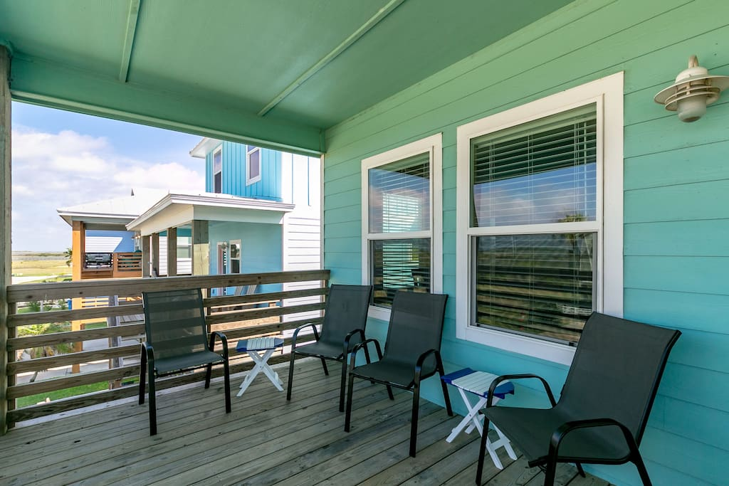 Enjoy the outdoor seating on the breezy balcony.