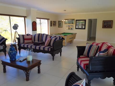 House with coastal views walking distance to beach