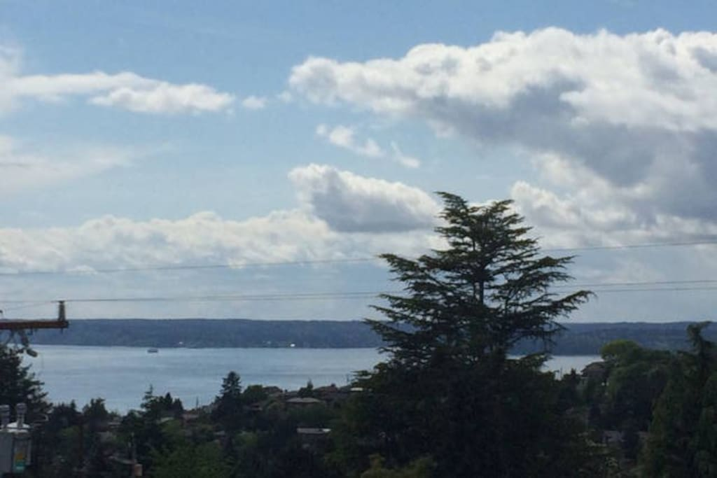 Views of Puget Sound and the Olympic and Cascade Mountain Ranges from the private roof deck on a clear day