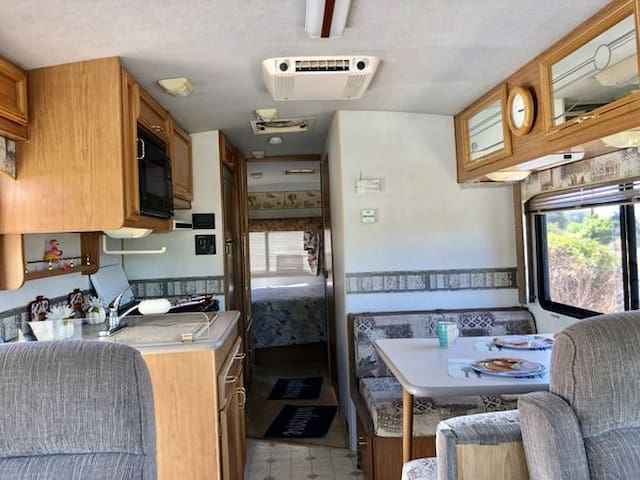 Class A RV Camping on River Channel