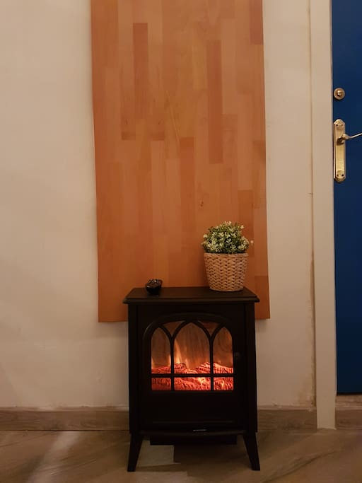 The moving realistic light-illusion fire place also delivers heat if desired