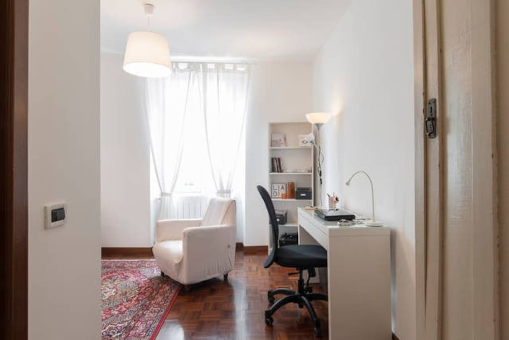 your room: desk and wi-fi, on the left the bathroom door