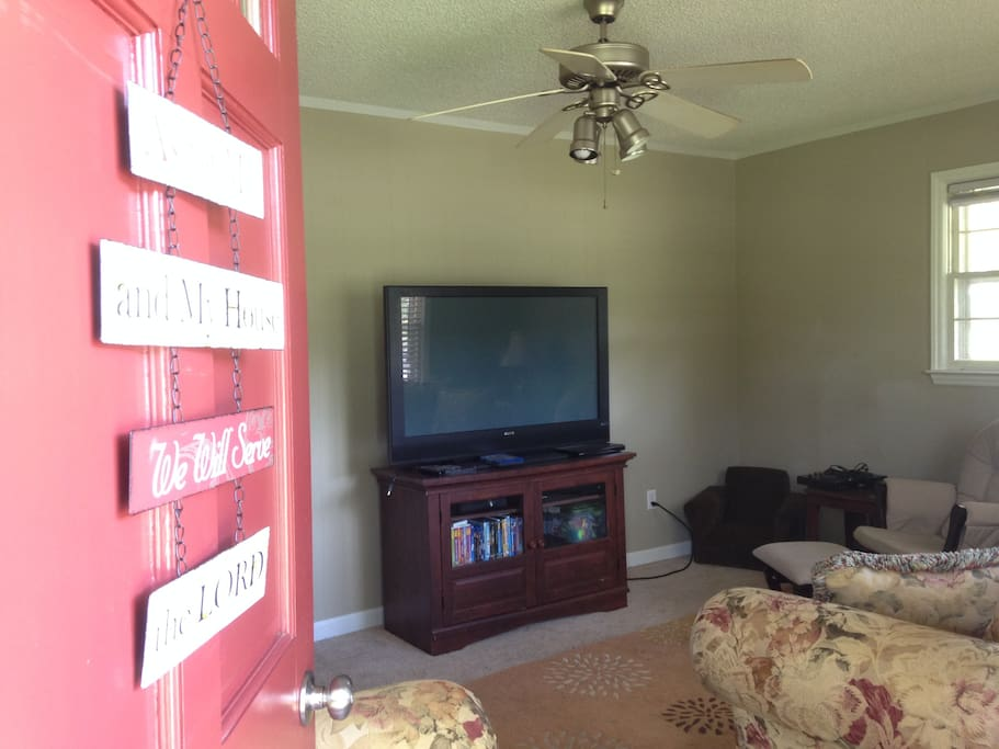 Living room with Satellite tv, Xbox 360 and lots of DVDs