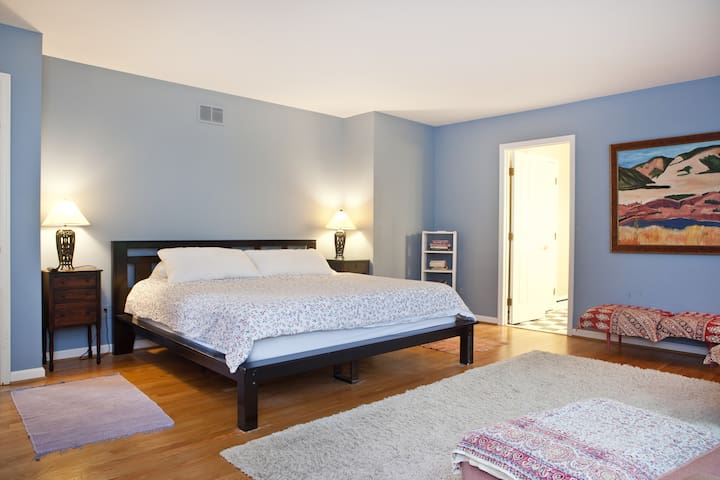 Master bedroom with king bed. There's lots of room here for a floor mattress too.