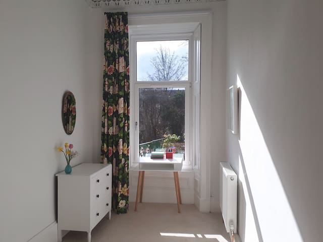 Bright, cheery, single room