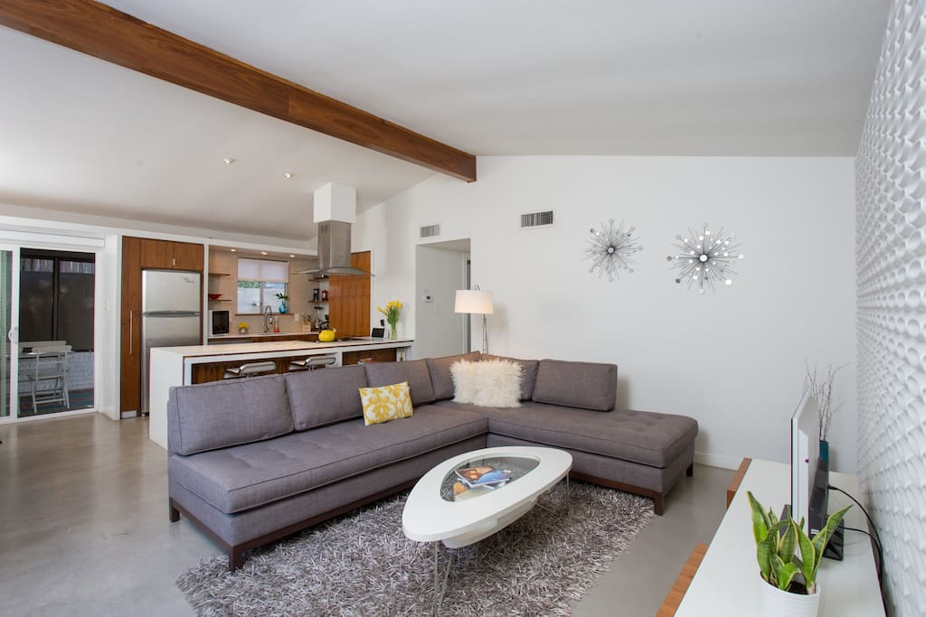 Living room features a sectional sofa. Plasma TV with premium cable package.