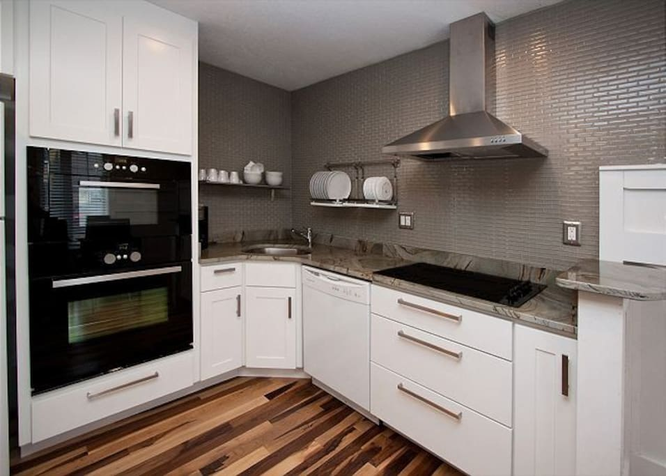 The Montagnana features a crisp modern kitchen complete with beautiful granite counter-tops.