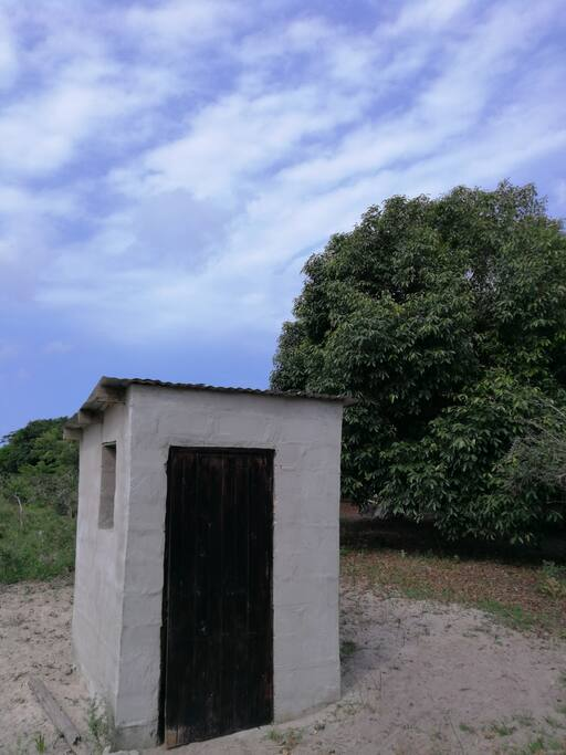 long drop toilet with incredible view across Lake Sibhayi