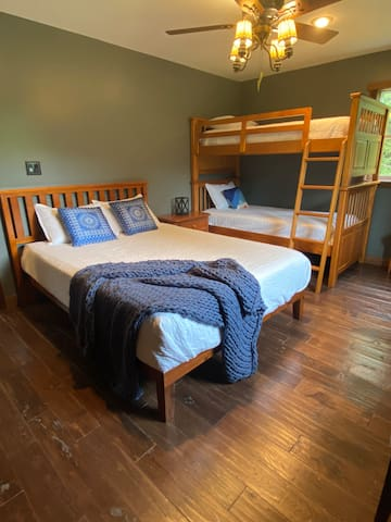 The master bedroom includes bunk beds for extra sleeping accommodations.