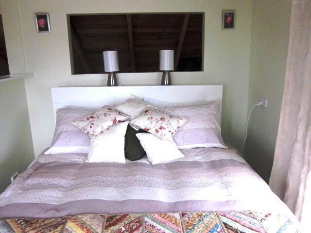 Queen-size bed in Main bedroom upstairs.