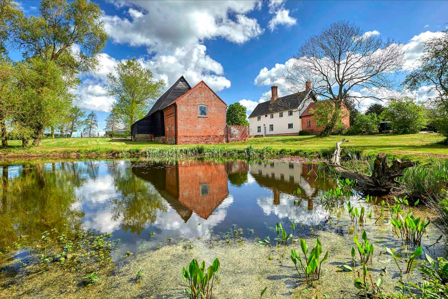 Brook Farm is a Grade 2* listed farmhouse set within two acres of mature gardens with its own lake. It also has a Grade 2 listed threshing barn used as a games room as well as a wood fired hot tub, play house and football pitch in the grounds.