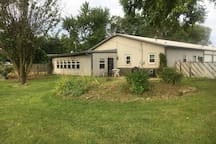 Spacious yard with two flower gardens.  Its fenced so your pet can safely enjoy this yard.