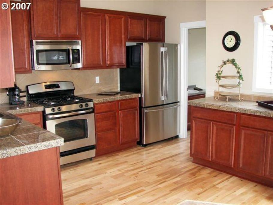 Gas range, large refrigerator, dishwasher, coffee maker