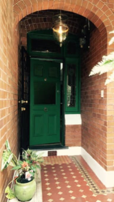 Front entrance. Cuban green door with security gate.