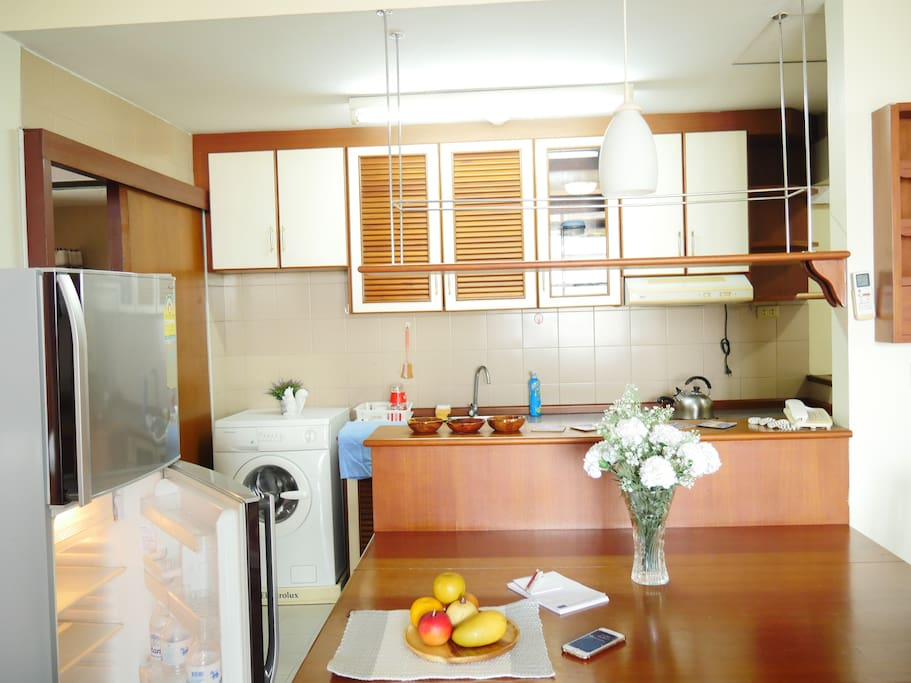 Full-furnish room with basic facilities such as washing machine, kitchen and refrigerator