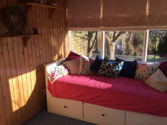 Double bed in sunny garden room - Kilmarnock