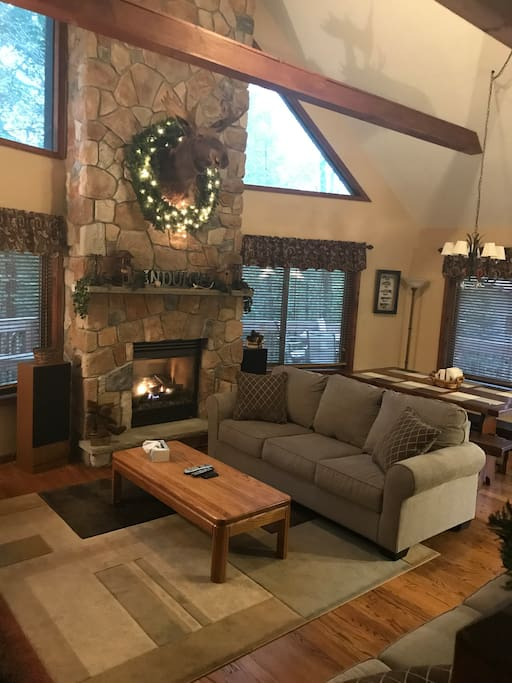 Living room with gas fireplace. New couches.