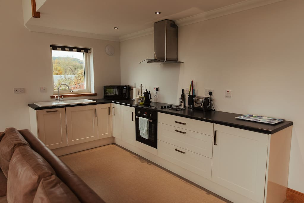 Bright, fully equipped modern kitchen.