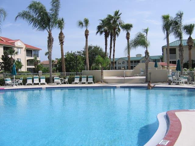 Garden level condo with pool access, gym & hot tub
