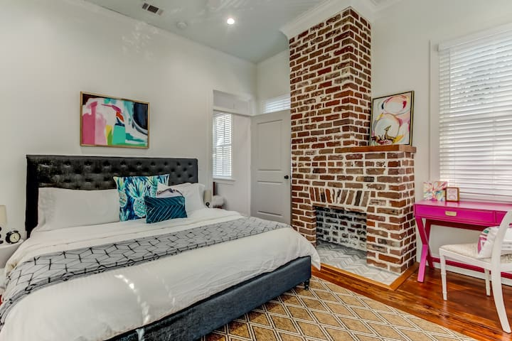 Master bedroom with king-sized bed and a great hot pink desk! BOTH bedrooms have private walk-in closets and en suite bathrooms!