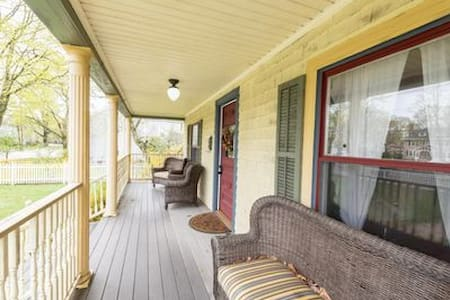 Spacious antique home- inside & out. Walk to train