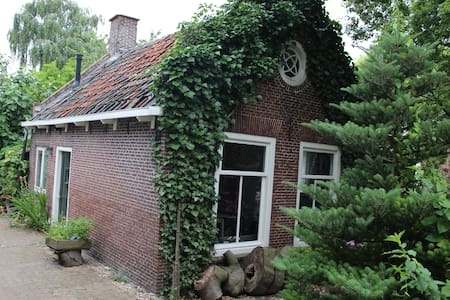 Typical dutch tiny house in the country from 1850